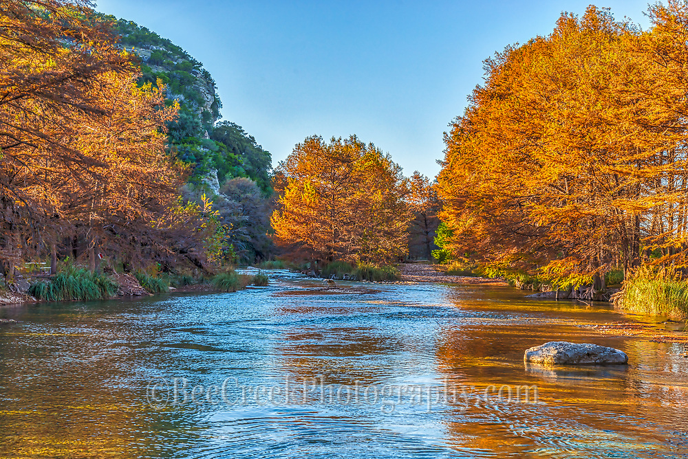 This lovely fall image ws capture along the Frio River in Con Can Texas.  The sun was low in the sky and was creating these golden shadows across the waters and highlighted the cypress trees with their fall foliage in display.