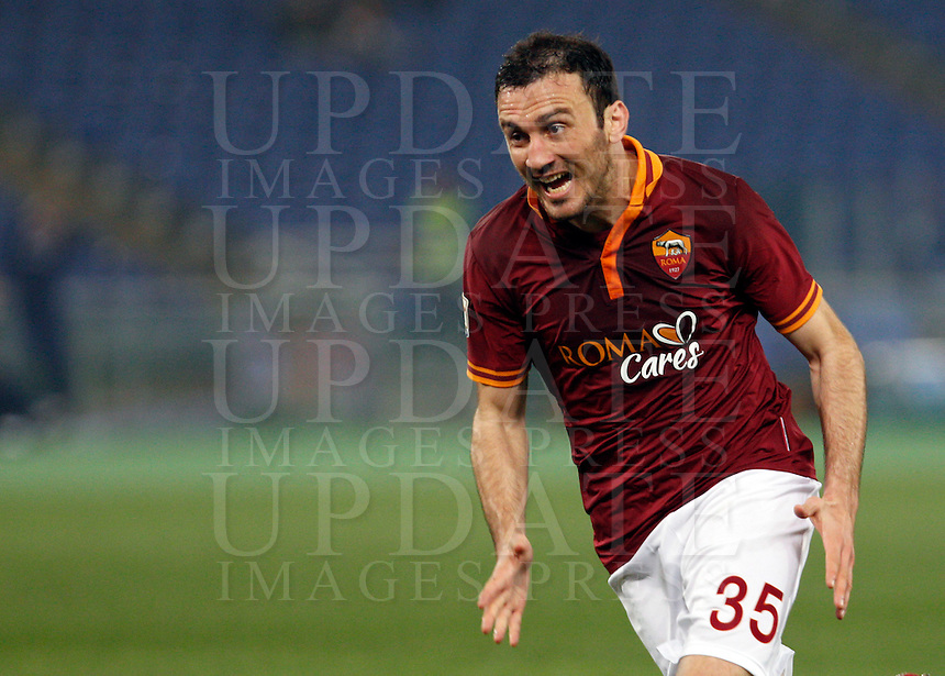 Calcio, Serie A: Roma vs Udinese. Roma, stadio Olimpico, 17 marzo 2014.<br /> AS Roma defender Vasilis Torosidis, of Greece, celebrates after scoring after scoring during the Italian Serie A football match between AS Roma and Udinese at Rome's Olympic stadium, 17 March 2014.<br /> UPDATE IMAGES PRESS/Riccardo De Luca