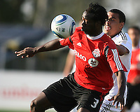 Charlie Davies#9 of D.C. United pushes into the back of Nana Attakora#3 of Toronto FC during the final round of the Carolina Challenge Cup on March 12 2011 at Blackbaud Stadium in Charleston, South Carolina. D.C. United won 2-1-.