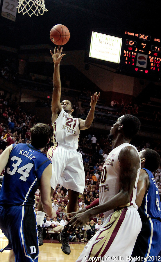 TALLAHASSEE, FLA. 2/23/12-FSU-DUKE022312 CH-FSU's Michael Snaer shoots over Duke's Ryan Kelly during second half action Feb. 23, 2012 in Tallahassee. The Blue Devils beat the Seminoles 74-66..COLIN HACKLEY PHOTO