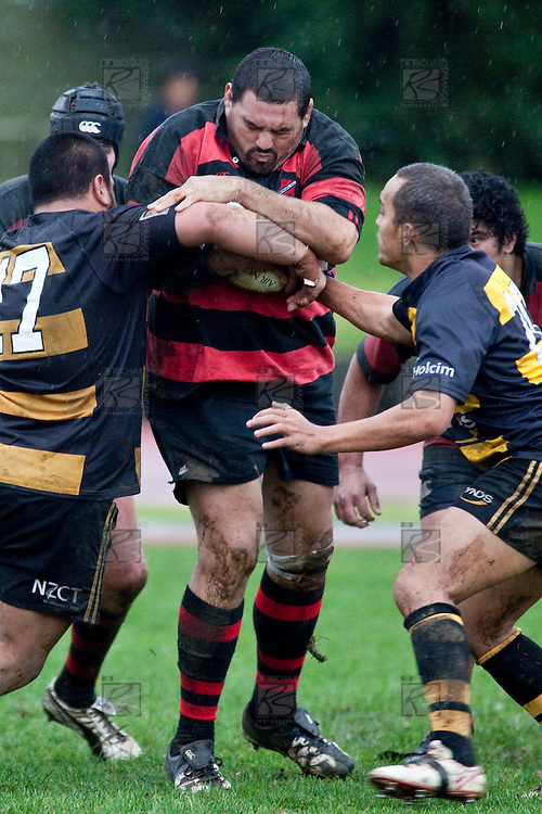 No way to celebrate his 100th game for Papakura. Nathan Te Puni gets hit in a hard tackle. Counties Manukau Premier Club Rugby game between Papakura & Bombay played at Massey Park Papakura on Saturday May 30th 2009..Bombay won 57 - 7 after leading 24 - 0 at halftime.