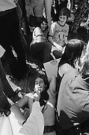 28 Jun 1970, Manhattan, New York City, New York State, USA. A gay couple, surrounded by the crowd, expresses their affection in Central Park during New York's first Gay Pride celebration.