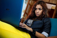 Ah Moon, the daughter of a Baptist minister and a member of 'Me N Ma Girls', Myanmar's first girl band, uses her laptop. The band's members were recruited by Australian dancer Nicole May. They sing and dance in the manner of many Western pop acts but in socially conservative Myanmar, they represent a radical break from the norm.
