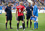 St Johnstone v FC Spartak Trnava...31.07.14  Europa League 3rd Round Qualifier<br /> Referee Mattias Gestranius slips the coin with captain's Dave Mackay and Marek Janecka<br /> Picture by Graeme Hart.<br /> Copyright Perthshire Picture Agency<br /> Tel: 01738 623350  Mobile: 07990 594431