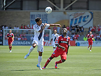 LA Galaxy defender A.J. DeLaGarza (20) heads the ball in front of Chicago midfielder Patrick Nyarko (14).  The LA Galaxy defeated the Chicago Fire 2-0 at Toyota Park in Bridgeview, IL on July 8, 2012.