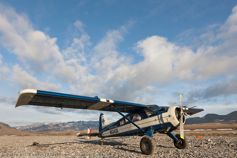 Pilot Dirk Nickisch of Coyote Air lands on the Kongakut river in a Dehaviland Beaver, Arctic National Wildlife Refuge, Brooks range, Alaska.