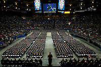 Police Officer Charles M. Mills (C, foreground) delivers the valedictorian address to the New York Police Department's Class of 2005 during the graduation ceremony, 29 December 2005, at the Madison Square Garden in New York City. 1,735 recruits were sworn in during the ceremony.