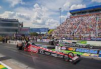 Sep 20, 2015; Concord, NC, USA; NHRA top fuel driver Leah Pritchett (near) races alongside Larry Dixon during the Carolina Nationals at zMax Dragway. Mandatory Credit: Mark J. Rebilas-USA TODAY Sports