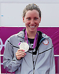 USA's Haley Anderson shows off her silver medal she won in the Women's Swimming Marathon at the London Olympics on Thursday, August 9, 2012, in London, England. (AP Photo/Margaret Bowles)