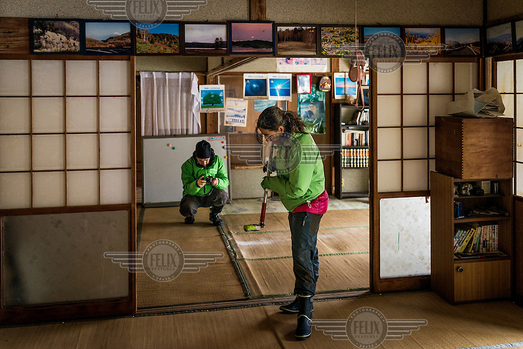 Raquel Monton, head of Greenpeace's anti-nuclear energy campaign, measuring radiactivity in the house of Turo Anzai in the village of Itate. Radiation levels remains above levels permitted by the government following the 2011 Fukushima Daiichi nuclear disaster.  On 11 March 2011 a magnitude 9 earthquake struck 130 km off the coast of Northern Japan causing a massive tsunami that swept across the coast of Northern Honshu damaging the Fukushima Daiichi nuclear power plant and triggering the worst nuclear accident since Chernobyl. The plant was shut down and a 20 km evacuation zone around the plant was declared by the government. Levels of radiation in the evacuation zone remain high.