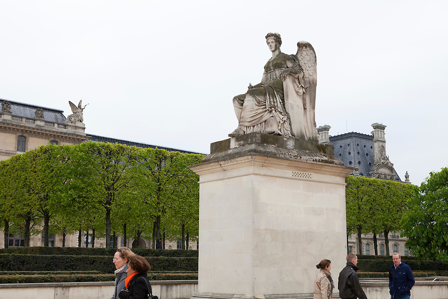 Statue of a seated, winged woman, Place du Carrousel, between the Louvre Museum and Tuileries Gardens, Paris, France, Europe