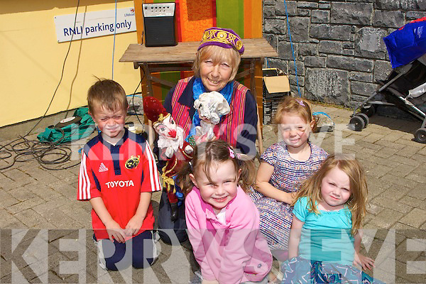 ....PUNCH & JUDY: Enjoying the Punch & Judy show at the Fenit Regatt to raise funds for the RNLI in Fenit on Sunday, L-r: Tom and Clodagh Strike,Megan O'Leary,Lucy Murphy (Fenit) and the pupteer Ros Ward...... ..