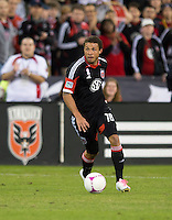 Nick DeLeon (18) of D.C. United brings the ball upfield during the game at RFK Stadium in Washington, DC.  D.C. United defeated the Columbus Crew, 3-2.