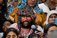 A Peruvian actor Mario Valencia, performing as Jesus Christ, sings in the Good Friday procession during the Holy week in Lima, Peru, 30 March 2013. The annual Passion Of Christ procession, held as part of Easter celebrations, starts in Lima downtown and, followed by thousands of catholic believers, it climbs to the top of the dry and rocky hill of San Cristobal, where Mario Valencia, who has been playing the role of Jesus Christ for more than 30 years, is symbolically crucified.