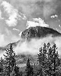 Fog rises above a mountain in Yellowstone National Park.