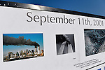 "East Meadow, New York, U.S. 11th September 2013. The Global War on Terror ""Wall of Remembrance"" a traveling memorial on display in New York for the first time, is at Eisenhower Park on the 12th Anniversary of the terrorist attacks of 9/11. The unique 94 feet long by 6 feet high wall has, on one side, almost 11,000 names of those lost on September 11th 2001, along with heroes and veterans who lost their lives defending freedom of Americans over past 30 years. On the wall's other side is a timeline, with photos, covering 1983 to present day."