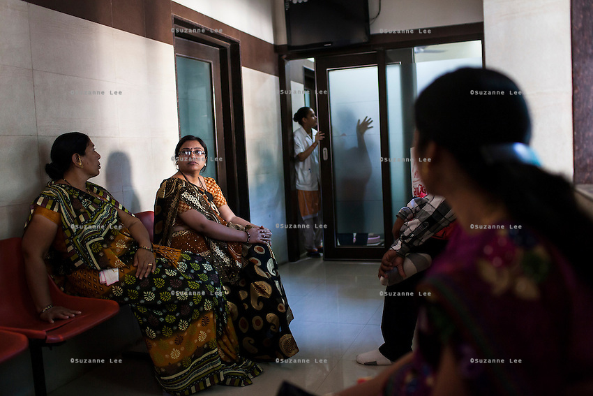 Nurses go in and out of the treatment room while general gynae patients wait at the Akanksha Clinic in Anand, Gujarat, India on 11th December 2012. Photo by Suzanne Lee / Marie-Claire France