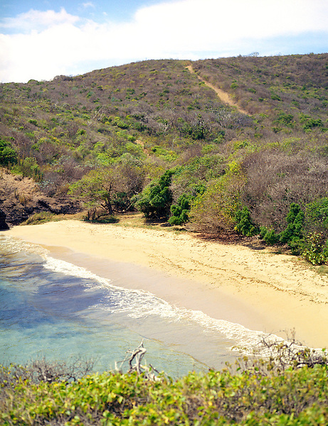 CAS EN BAS, ST.LUCIA : A view of Secret Beach in St. Lucia. A secluded beach south of Cas En Bas on the Atlantic side of the island. Secret Beach is very secluded and strewn with volcanic rocks. Cas En Bas, St. Lucia, W.I.