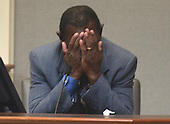 President and publisher of Bessamer Daily News in Bessamer, Alabama, James Allen Gray Jr., covers his face as he identified Lee Boyd Malvo during testimony in the trial of sniper suspect John Allen Muhammad, in courtroom 10 at the Virginia Beach Circuit Court in Virginia Beach, Virginia, Wednesday October 22, 2003. Gray chased a suspect in a shooting at a liquor store in Alabama in 2002. <br /> Credit: Davis Turner - Pool via CNP