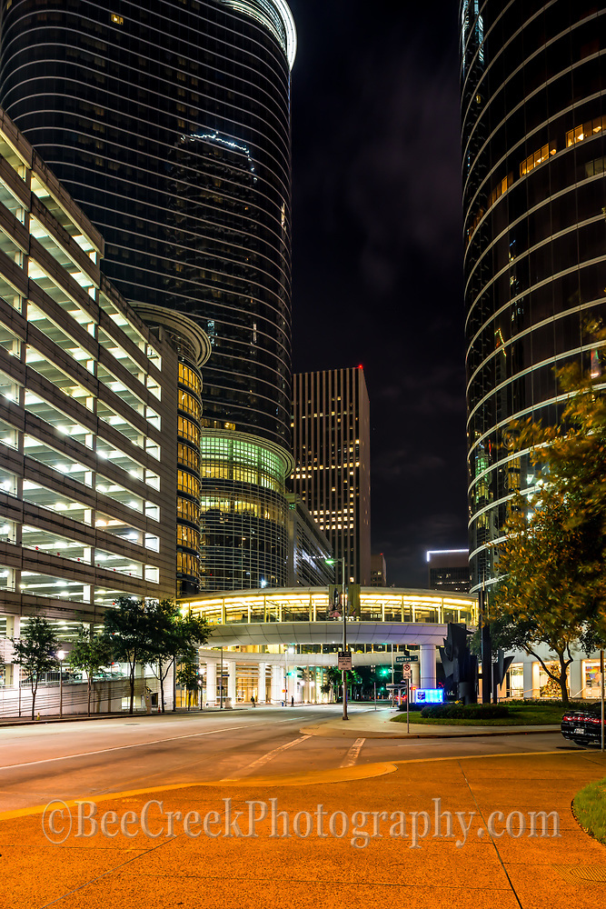 This photo was captured at night of Houston 1400 Smith St building which was formerly the Enron buildings and was purchase by Chevron in June 2011.  It is a complex of several building which are some of the city's tallest modern skyscrapers.