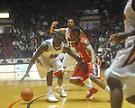 Ole Miss guard Nick Williams (20) is defended by Georgia's Gerald Robinson (22) at the C.M. &quot;Tad&quot; Smith Coliseum in Oxford, Miss. on Saturday, January 15, 2011. Georgia won 98-76.  (AP Photo/Oxford Eagle, Bruce Newman)
