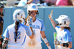 24 April 2016: North Carolina's Kristen Brown (12), Leah Murray (4), and Destiny DeBerry (22) congratulate each other. The University of North Carolina Tar Heels hosted the University of Notre Dame Fighting Irish at Anderson Stadium in Chapel Hill, North Carolina in a 2016 NCAA Division I softball game. UNC won game 1 of the doubleheader 7-4.