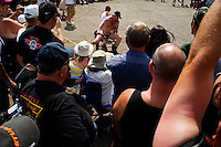 Crowds gather to watch the Undie 500 competition at the Testicle Festival in Clinton, MT, in which racers drink beer, ride tricycles, and remove articles of clothing when they perform poorly.  Many contestants were fully naked by the end of the competition. The Rock Creek Lodge in Clinton, MT, has hosted the annual Testicle Festival since the early 1980s.  The four day festival and party revolves around the consumption of so-called Rocky Mountain Oysters, which are deep-fried bull testicles.