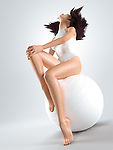 Young woman with fit slim body sitting on white exercise ball isolated on white background. Fitness and health concept. Photorealistic 3D illustration.