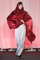 Model walks runway in an outfit by Hannah Slocum, for the Syracuse University, College of Visual and Peforming Arts 2011 Fashion Show Gala.
