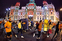 Runners passing by the Cibeles Square during the San Silvestre Marathon 2012 in Madrid