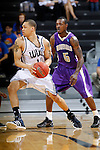 24 MAR 2012:  Paul Jones (11) of Western Washington University looks for an open teammates against the University of Montevallo during the Division II Men's Basketball Championship held at the Bank of Kentucky Center in Highland Heights, KY.  Western Washington defeated Montevallo 72-65 for the national title.  Joe Robbins/NCAA Photos