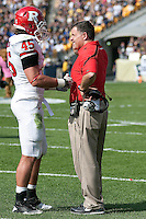 Rutgers head coach Greg Schiano listens to defensive end Alex Silvestro after Pitt scored a touchdown. The Pittsburgh Panthers defeated the Rutgers Scarlet Knights 41-21 on October 23, 2010 at Heinz Field, Pittsburgh, Pennsylvania....