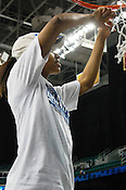 All-America candidate Jasmine Thomas cuts down a part of the net. (Photo by Rob Rowe)