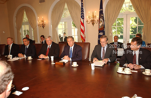 United States President George W. Bush briefs members of Congress in the Cabinet Room of the White House in Washington, D.C.on the terrorist attack in New York and Washington on Wednesday, September 12, 2001.  Left to right: U.S. House Minority Leader Dick Gephardt (Democrat of Missouri); Central Intelligence Agency (CIA) Director George Tenent; Speaker of the U.S. House Dennis Hastert (Republican of Illinois); President Bush; U.S. Secretary of Defense Donald Rumsfeld; U.S. Senate Majority Leader Tom Daschle (Democrat of South Dakota)..Credit: Ron Sachs / CNP
