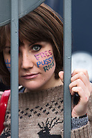 Moscow, Russia, 01/10/2012. A Pussy Riot supporter refused entry to Moscow City Court precincts stares in through security bars from outside. Supporters and opponents of band members Maria Alyokhina, Yekaterina Samutsevich and Nadezhda Tolokonnikova demonstrated outside the court as the three appealed against their two-year jail sentence for their performance in the Christ The Saviour Cathedral. The appeal was postponed until October 10th after Samutsevich fired her lawyer.