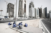 Qatar - Doha - Workers having lunch in Financial District