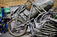 A broken old bicycle, together with bicycle frames, is seen in a small scale bicycle factory in Cali, Colombia, 27 June 2014. Due to the strong, vibrant cycling culture in Colombia, with cycling being one of the two most popular sports in the country, dozens of bike workshops and artisanal, often family-run bicycle factories were always spread out through the Colombian cities. However, growing import of cheap bicycles and components from China during the last decade has led to a significant decline in domestic bicycle production. Traditional no-name bike manufacturers are forced to close down their factories, struggling to survive in the competitive bicycle market.