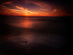 Dramatic dark red sunset over lake Huron, Pinery Provincial Park, Grand Bend, Ontario, Canada.
