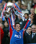 Rangers captain Barry Ferguson lifts the CIS Cup in 2002 after the final at Hampden Park