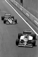 DETROIT, MI - JUNE 22: Nelson Piquet of Brazil drives the Williams FW11/Honda RA166E ahead of Jacques Laffite of France in the Ligier JS27/Renault EF4Bduring the Detroit Grand Prix FIA Formula One World Championship race on the Detroit Street Circuit in Detroit, Michigan, on June 22, 1986..