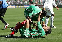 Alberto Medina (top) helps up Israel Martinez (20) after getting the panlty shot called his way. Mexico defeated Nicaragua 2-0 during the First Round of the 2009 CONCACAF Gold Cup at the Oakland, Coliseum in Oakland, California on July 5, 2009.