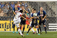 Dwayne De Rosario (7) of D. C. United takes a free kick as Brian Carroll (7), Sebastien Le Toux (11), Michael Farfan (21), and Conor Casey (6) of the Philadelphia Union form a wall. The Philadelphia Union defeated D. C. United 2-0 during a Major League Soccer (MLS) match at PPL Park in Chester, PA, on August 10, 2013.