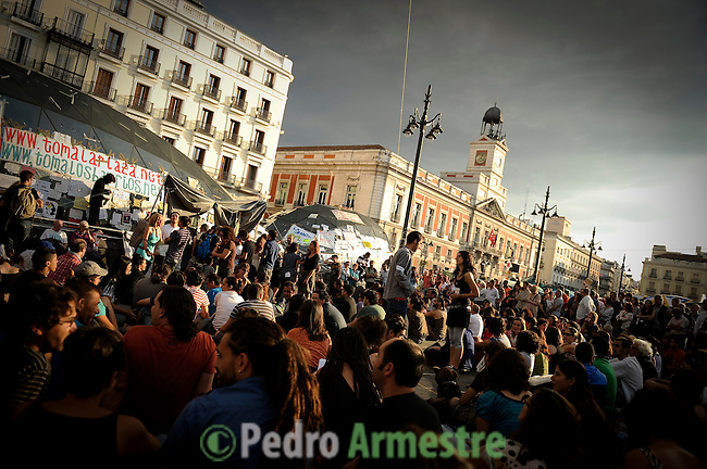 Thousands of demonstrators gather on the Puerta del Sol square in central Madrid on June 5, 2011 during a protest to decry mainstream political parties, soaring unemployment, corruption and welfare cuts. The leading protest group known as &quot;the indignants&quot; met today to decide whether to carry on their camp-out against political corruption and joblessness. (c) PEDRO ARMESTRE