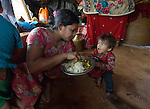Sarita Majhi eats with her children, including 1-year old Sanira, in their temporary shelter in Adamtar, a village in the Dhading District of Nepal. Dan Church Aid, a member of the ACT Alliance, has provided food, shelter, livelihood, winterization assistance and a variety of other support to Majhi and other indigenous villagers here in the wake of a devastating 2015 earthquake. Majhi has had to face the earthquake and its aftermath alone, as her husband is working in Saudi Arabia. He stopped sending money home and told Majhi to quit calling him.