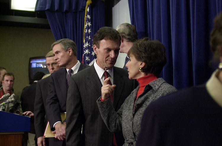 4leadership120500 -- Tom Daschle, D-S.D., talks with Barbara Boxer, D-Calif., after a press conference in the Senate Radio and T.V. gallery about the democratic deadership elections.