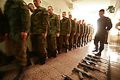 The last draft. Soldeirs gathering for early morning assembly, with AK-47 Kalashnikov rifles laid out on the floor. <br /> .Warsaw, Poland, June 2008.(Photo by Piotr Malecki / Napo Images).<br /> Ostatni pobor.Zolnierze na kompanii w jednostce w Warszawie.5/2008.<br /> Fot: Piotr Malecki / Napo Images