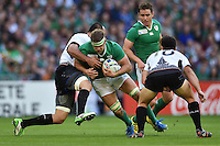 Chris Henry of Ireland takes on the Romania defence. Rugby World Cup Pool D match between Ireland and Romania on September 27, 2015 at Wembley Stadium in London, England. Photo by: Patrick Khachfe / Onside Images