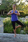 Stock Photos of a young Hispanic woman doing yoga
