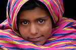 Following an October 8, 2005, earthquake, a girl living in a tent city outside Balakot, Pakistan. The quake measured 7.6 on the Richter scale and killed more than 74,000 people in northern Pakistan.