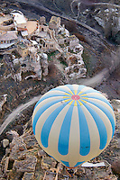 Ortahisar, Cappadocia, Nevsehir, Turkey, December 2009. Flying over the Village of Ortahisar. Hot air ballooning is the number one activity in Capadocia. The fairy landscape of Goreme National Park is unique in its kind. Millions of years long, wind and water sculpted the tuffstone into spectacular rock formations.  Photo by Frits Meyst / MeystPhoto.com